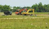 Lợi dụng cải tạo đồng ruộng để... bán đất