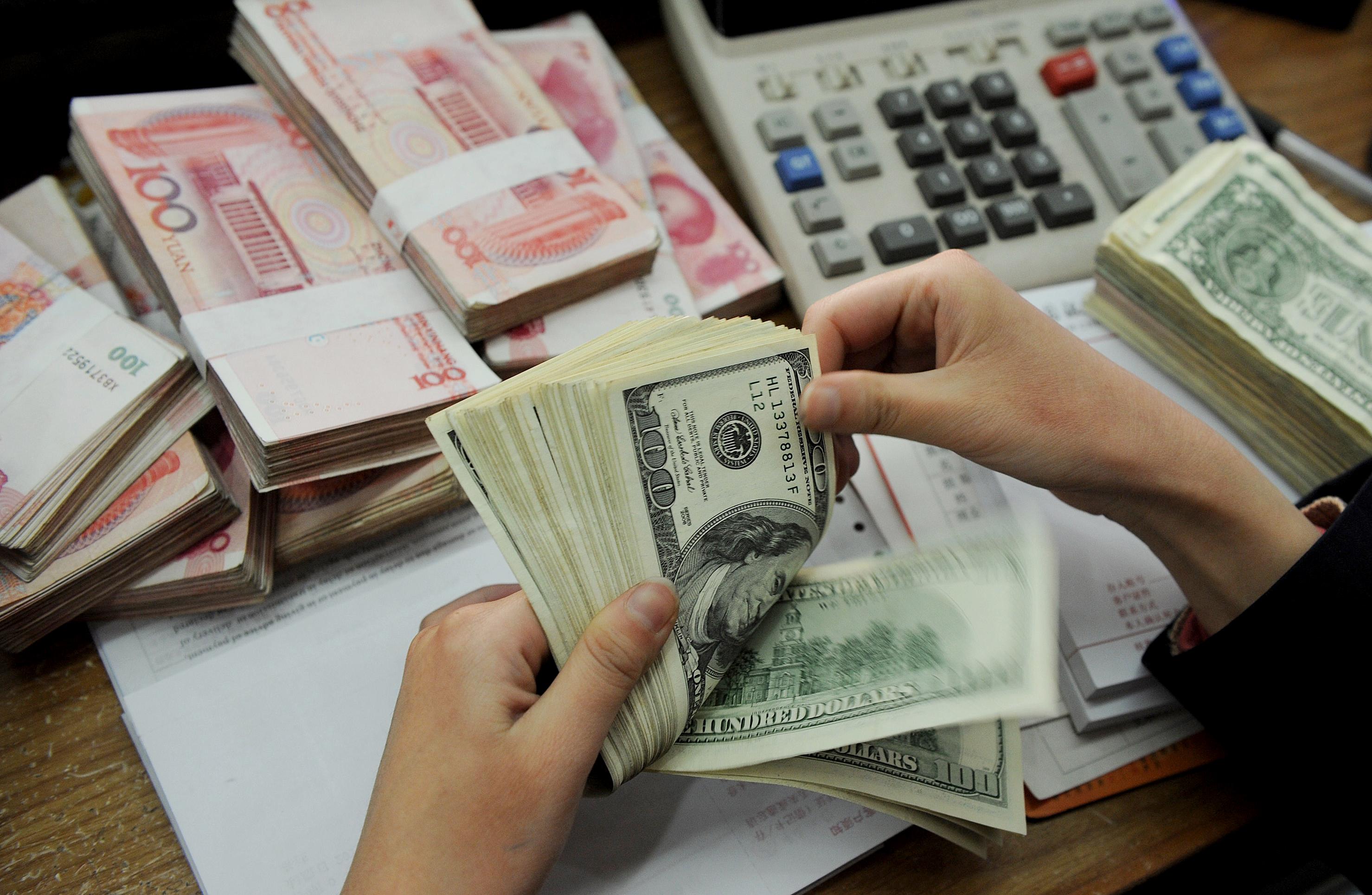 USD lại lên giá 23.300 đồng/USD, CNY giảm giá thấp nhất trong vòng