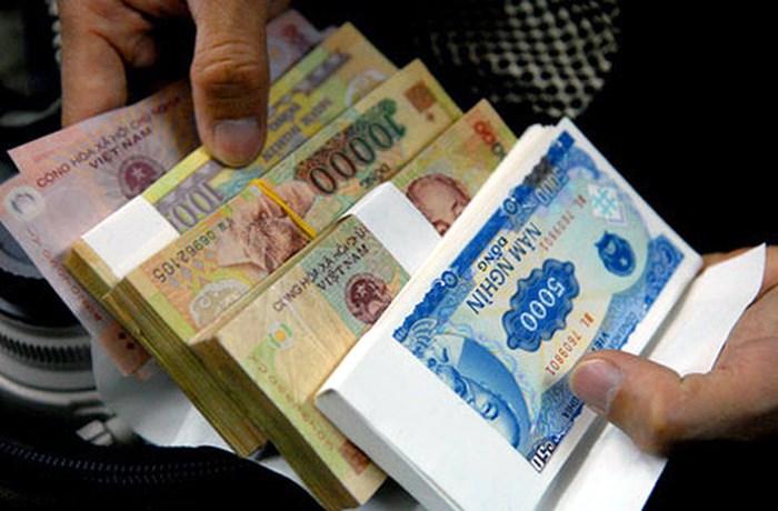 NHNN yêu cầu xử lý nghiêm tình trạng đổi tiền lẻ thu phí