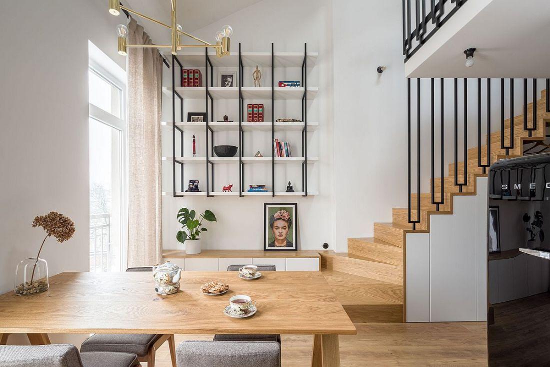 Với thiết kế cầu thang cho nhà có gác lửng sử dụng chất liệu gỗ đồng bộ với sàn, nội thất đã đem đến một không gian rộng rãi và thoáng đãng hơn.