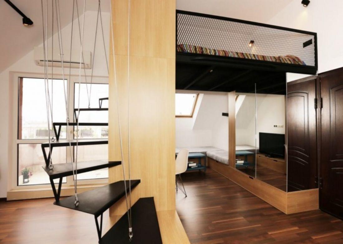 Phong cách cầu thang treo hiện đại, độc đáo màu đen thể hiện phong cách sống trẻ trung và đầy ấn tượng. Đối với việc bố trí cầu thang đẹp cho nhà gác lửng thì đây chính là một phương án tương đối khả thi.